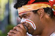 Australian Aborigine plays didgeridoo, New South Wales, Australia