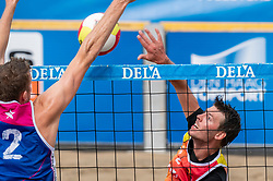 Jeffrey van Wijk in action. The DELA NK Beach volleyball for men and women will be played in The Hague Beach Stadium on the beach of Scheveningen on 22 July 2020 in Zaandam.