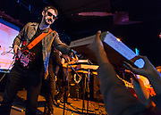WASHINGTON, DC - March 21st, 2014 - Matt Colbourn of the Pizza Underground hands out pizza to fans at their performance at the Black Cat in Washington, D.C. (Photo by Kyle Gustafson / For The Washington Post)
