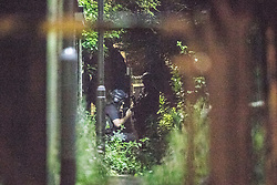 © Licensed to London News Pictures . 26/07/2017 . Oldham , UK . Armed police in an alleyway adjacent to the scene where an armed siege that began at 3.15am on Tuesday 25th July in a house on Pemberton Way in Shaw , is ongoing in to a second night . A man named locally as Marc Schofield is reported to be holding a woman hostage after earlier releasing two children . The gas supply in the area has been cut off and several neighbouring properties have been evacuated . Photo credit : Joel Goodman/LNP