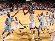Jan. 8, 2011; Charlottesville, VA, USA;  Virginia Cavaliers center Assane Sene (5) grabs the rebound during the game against the North Carolina Tar Heels at the John Paul Jones Arena. North Carolina won 62-56. Mandatory Credit: Andrew Shurtleff