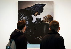© Licensed to London News Pictures. 22/10/2012. LONDON, UK. Two members of the public view 'Batman v Penguin', a digital painting created by Kan Muftic for the computer game 'Batman - Arkham City', at an exhibition at London's City Hall. The exhibition, entitled 'The Games Art Festival', showcases the best of videogame art and runs from the 22nd to the 26th of October as part of the 'London Games Festival 2012'. Photo credit: Matt Cetti-Roberts/LNP
