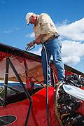 Ben Davidson, chief pilot at WAAAM, fueling the 1928 Waco ATO.