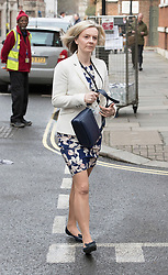 © Licensed to London News Pictures.23/03/2017.London, UK. Justice Secretary Liz Truss walks to Parliament through back streets, the day after a lone terrorist killed 4 people and injured several more, in an attack using a car and a knife. The attacker managed to gain entry to the grounds of the Houses of Parliament, killing one police officer.Photo credit: Peter Macdiarmid/LNP