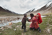 Aziz's daughter gets angry at her brother for not wanting to help her bring the water back to camp. Khan's summer camp of Kara Jylga...Daily life at the Khan (chief) summer camp of Kara Jylga...Trekking through the high altitude plateau of the Little Pamir mountains (average 4200 meters) , where the Afghan Kyrgyz community live all year, on the borders of China, Tajikistan and Pakistan.