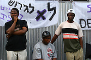 "Activists for the African workers in Israel union, sign people on a petition in attempt to prevent banishment of african refugees children and children of migrant workers.  Saturday, May 12, 2007. A black music festival ""Groove Refugee"" took place in Tel Aviv, all income will serve the struggle to prevent those children deported from Israel."