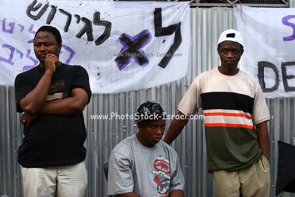"""Activists for the African workers in Israel union, sign people on a petition in attempt to prevent banishment of african refugees children and children of migrant workers.  Saturday, May 12, 2007. A black music festival """"Groove Refugee"""" took place in Tel Aviv, all income will serve the struggle to prevent those children deported from Israel."""