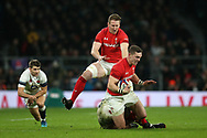 George North of Wales tries to break a tackle from Owen Farrell of England as Bradley Davies of Wales arrives in support. England v Wales, NatWest 6 nations 2018 championship match at Twickenham Stadium in Middlesex, England on Saturday 10th February 2018.<br /> pic by Andrew Orchard, Andrew Orchard sports photography
