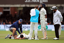India's Virat Kohli gets treatment for a bad back during day four of the Specsavers Second Test match at Lord's, London.