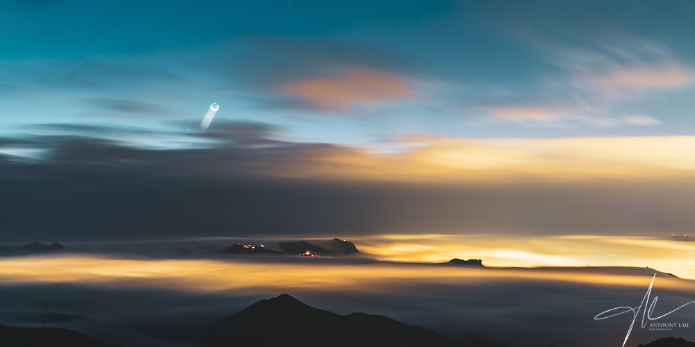 A magical moment when a huge sea of cloud fully covered Hong Kong city right before sunrise. A feast of colour from the stars, moon, twilight and cityglow.