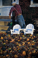 two miniature adirondack style wooden chairs Fall landscape homemade scare crow