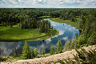Clouds reflect in the bends of the Au Sable River.