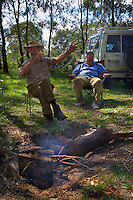 Lionel Swift (left), and Robert Hodder telling story at the camp fire. Opening of duck hunting season on the Murray Rive near Howlong. Pic By Craig Sillitoe CSZ/The Sunday Age. 19/3/2011 This photograph can be used for non commercial uses with attribution. Credit: Craig Sillitoe Photography / http://www.csillitoe.com<br /> <br /> It is protected under the Creative Commons Attribution-NonCommercial-ShareAlike 4.0 International License. To view a copy of this license, visit http://creativecommons.org/licenses/by-nc-sa/4.0/.
