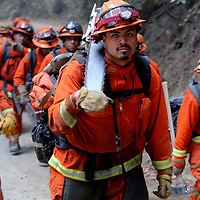 A California Department of Corrections and Rehabilitation fire crew heads up Bear Creek Canyon Road as they assist on the fire lines of the Bear Fire near Boulder Creek, California on Wednesday October 18, 2017.<br /> Photo by Shmuel Thaler <br /> shmuel_thaler@yahoo.com www.shmuelthaler.com