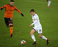 Tom Carroll of Swansea city looks to go past Matt Doherty of Wolverhampton Wanderers (l). The Emirates FA Cup, 3rd round replay match, Swansea city v Wolverhampton Wanderers at the Liberty Stadium in Swansea, South Wales on Wednesday 17th January 2018.<br /> pic by  Andrew Orchard, Andrew Orchard sports photography.