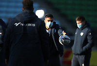 Racing players playing with a ball after arriving at the ground wearing masks