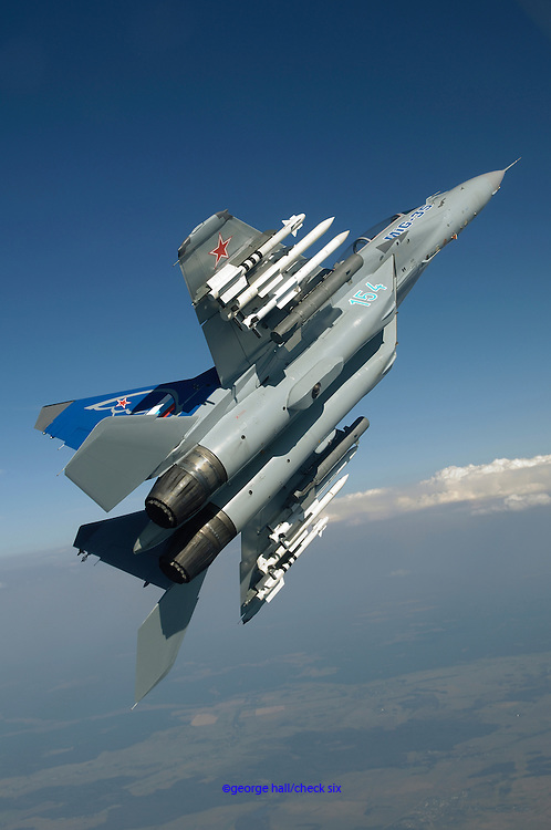 MiG35 fully loaded with missiles pulling up