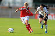 Jessica Fishlock of Wales (10) breaks away from Ingrid Moe Wold of Norway .. Wales Women v Norway Women, Women's Euro 2017  Qualifying, group 8 match at the Newport Stadium in Newport, South Wales on Tuesday 7th June 2016. pic by  Andrew Orchard, Andrew Orchard sports photography.