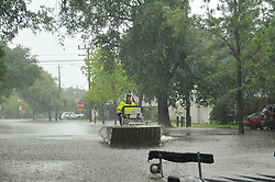 Aug 28, 2017 - Houston, Texas, U.S. - A volunteer unloading the boat from the trailer to begin helping any families still in need of rescue in the Meyerland area Monday morning. The streets are still under water and more rain is expected. (Credit Image: © George Wong via ZUMA Wire)