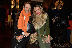***UK_MAGAZINES_OUT***<br /> LONDON, ENGLAND 30 NOVEMBER 2016: <br /> Left to right, Michele Codoni, Marie Mahti at the launch of In The Spirit of Gstaad at Maison Assouline, Piccadilly, London hosted by Mandolyna Theodoracopulos and Homera Sahni England. 30 November 2016.