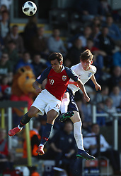 England's James Garner (right) and Norway's Josef Brian Baccay battle for the ball during the UEFA European U17 Championship quarter final match at the Pirelli Stadium, Burton.