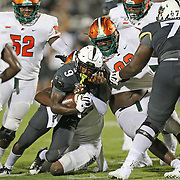 ORLANDO, FL - AUGUST 29: Adrian Killins Jr. #9 of the UCF Knights gets tackled by the the Florida A&M Rattlers defense during a NCAA football game on August 29 2019 in Orlando, Florida. (Photo by Alex Menendez/Getty Images) *** Local Caption *** Adrian Killins Jr