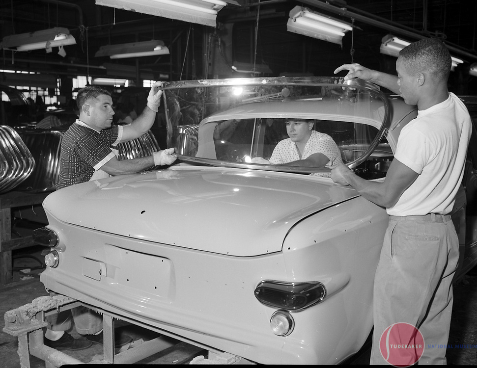 Studebaker workers install the back glass on a 1960 Studebaker Lark at the company's South Bend, Indiana, plant.