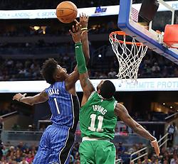November 5, 2017 - Orlando, FL, USA - Boston Celtics guard Kyrie Irving (11) blocks a shot by Orlando Magic forward Jonathan Isaac (1) on Sunday, Nov. 5, 2017 at the Amway Center in Orlando, Fla. Boston won the game, 104-88. (Credit Image: © Stephen M. Dowell/TNS via ZUMA Wire)