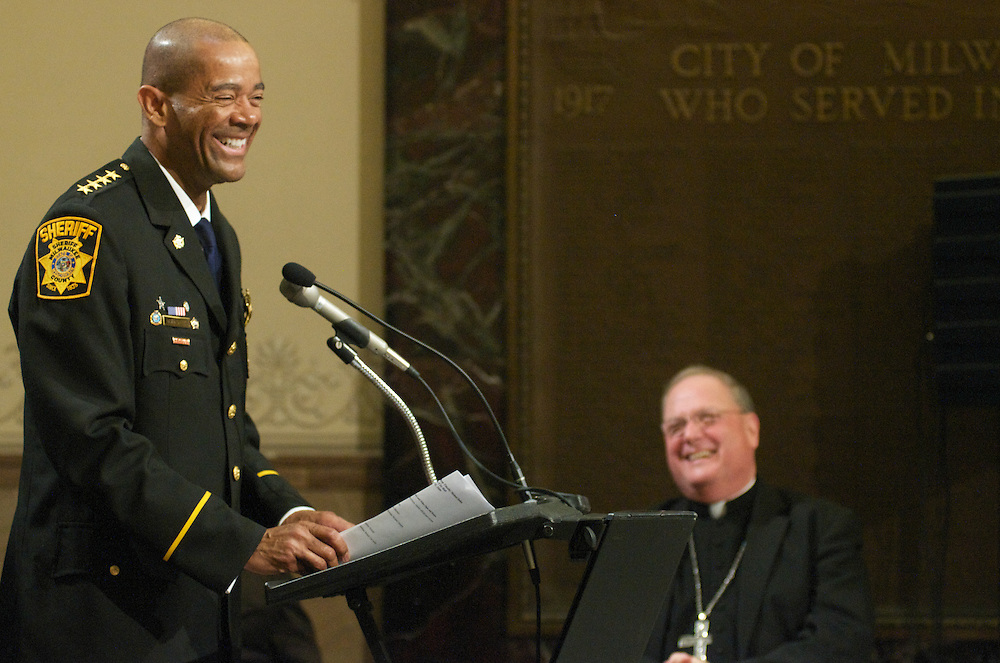 Sheriff David Clarke shares a laugh with Archbishop Dolan while thanking him during the farewell ceremony at City Hall, Tuesday March 31 2009.
