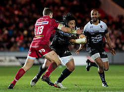 Toulon's Ma'a Nonu under pressure from Scarlets' Hadleigh Parkes<br /> <br /> Photographer Simon King/Replay Images<br /> <br /> European Rugby Champions Cup Round 6 - Scarlets v Toulon - Saturday 20th January 2018 - Parc Y Scarlets - Llanelli<br /> <br /> World Copyright © Replay Images . All rights reserved. info@replayimages.co.uk - http://replayimages.co.uk