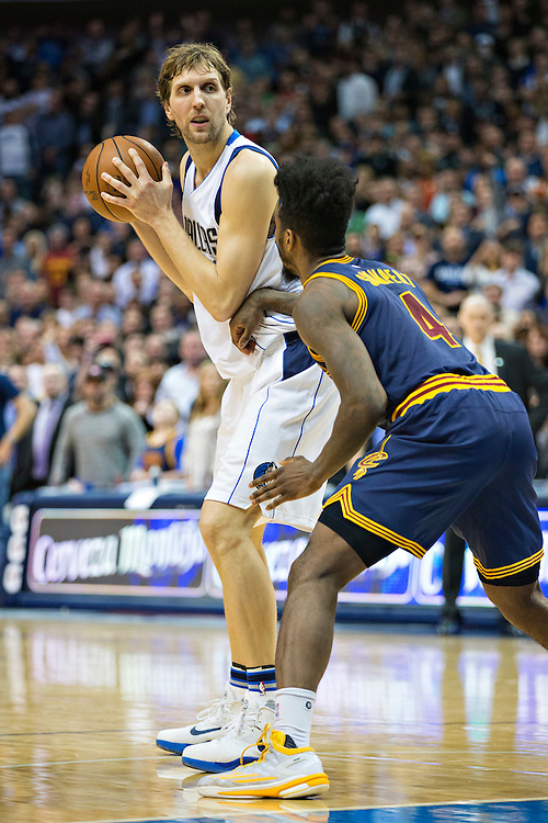 DALLAS, TX - JANUARY 12:  Dirk Nowitzki #41 of the Dallas Mavericks with the ball while being guarded by Iman Shumpert #4 of the Cleveland Cavaliers at American Airlines Center on January 12, 2016 in Dallas, Texas.  NOTE TO USER: User expressly acknowledges and agrees that, by downloading and or using this photograph, User is consenting to the terms and conditions of the Getty Images License Agreement.  The Cavaliers defeated the Mavericks 110-107.  (Photo by Wesley Hitt/Getty Images) *** Local Caption *** Dirk Nowitzki; Iman Shumpert