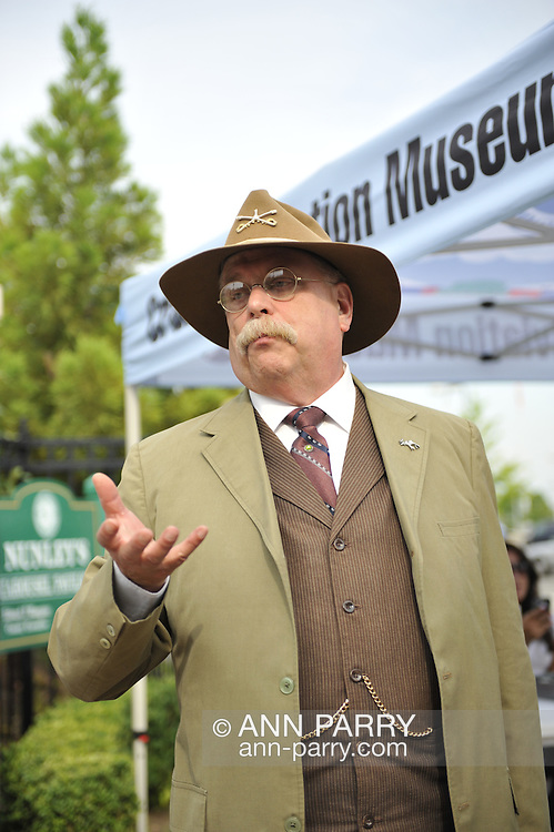 """U.S. President Theodore Roosevelt, played by actor James Foote, campaigning at historic Nunley's Carousel Centennial Celebration on Saturday, June 9, 2012, at Museum Row, Garden City, Long Island, New York, USA. 100th Anniversary festivities included old time game of croquet; a visit from """"Pres. Teddy Roosevelt""""  who ran again for President in 1912 (unsuccessfully, as Bull Moose Party candidate), the year Nunley's Carousel debuted; and Carousel rides."""