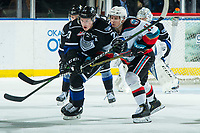 KELOWNA, BC - JANUARY 3: Gary Haden #23 of the Victoria Royals is checked by Pavel Novak #11 of the Kelowna Rockets during third period at Prospera Place on January 3, 2020 in Kelowna, Canada. (Photo by Marissa Baecker/Shoot the Breeze)
