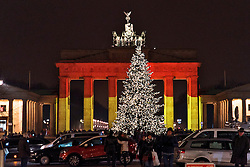 20.12.2016, Brandenburger Tor, Berlin, GER, Anschlag auf Berliner Weihnachtsmarkt, im Bild Brandenburger Tor, Schwarz,Rot,Gold beleuchtet // after a Truck sped into a Christmas market, killing at least twelve people and injuring dozens more Ambulances and heavily armed officers rushed to the area after the driver drove up the pavement of the market in a square popular with tourists. Brandenburg Gate in Berlin, Germany on 2016/12/20. EXPA Pictures © 2016, PhotoCredit: EXPA/ Eibner-Pressefoto/ Koch<br /> <br /> *****ATTENTION - OUT of GER*****