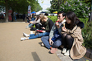 Friends eating ice cream during a food festival. The South Bank is a significant arts and entertainment district, and home to an endless list of activities for Londoners, visitors and tourists alike.