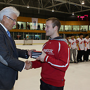 Radosvet Petrov, Bulgaria,  receives the 'Best Player of the Team' award for the tournament from Kai Hietariinta, IIHF Tournament Chairman at the conclusion of the 2012 IIHF Ice Hockey World Championships Division 3 held at Dunedin Ice Stadium. Dunedin, Otago, New Zealand. 22nd January 2012. Photo Tim Clayton