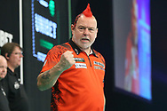 Peter Wright beats James Wade and celebrates during the PDC Unibet Premier League darts at Marshall Arena, Milton Keynes, United Kingdom on 24 May 2021.