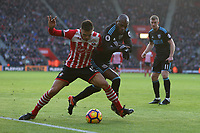 Football - 2016 / 2017 Premier League - Southampton vs. West Bromwich Albion<br /> <br /> Southampton's Dusan Tadic leans into Allan Nyom of West Bromwich Albion to hold him off the ball at St Mary's Stadium Southampton England<br /> <br /> COLORSPORT/SHAUN BOGGUST