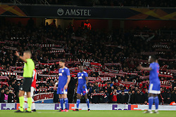 Olympiacos fans hold up their scarves - Mandatory by-line: Arron Gent/JMP - 27/02/2020 - FOOTBALL - Emirates Stadium - London, England - Arsenal v Olympiacos - UEFA Europa League Round of 32 second leg