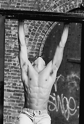 Toned man holding on to a door frame in New York City