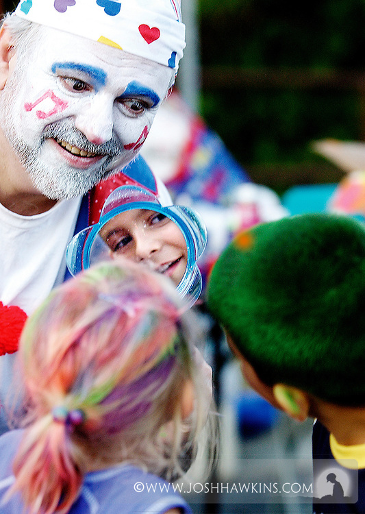 """The Clown """"Notes"""" who was coloring kids hair, shows Samantha Bloom and Jacob Angio their new dos during the North Riverside's North Riverside Day at Village Commons in North Riverside, IL.."""