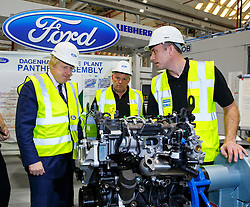 © Licensed to London News Pictures. 25/11/2014. LONDON, UK. Boris Johnson visits the Ford Dagenham engine plant in east London on Tuesday, 25 November 2014. The Mayor of London is given a tour of the company's new high-tech engine assembly line and briefed about Ford's £475m in the site, which made it one of the biggest and longest-established factories of its kind in Europe. Photo credit : Tolga Akmen/LNP