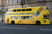Yellow Routemaster bus advertising Chiquita curved bananas on 11th August 2021 in London, United Kingdom. Chiquita Brands International Sarl, formerly known as Chiquita Brands International Inc. is a producer and distributor of bananas and other produce. The company operates under a number of subsidiary brand names, including the flagship Chiquita brand.