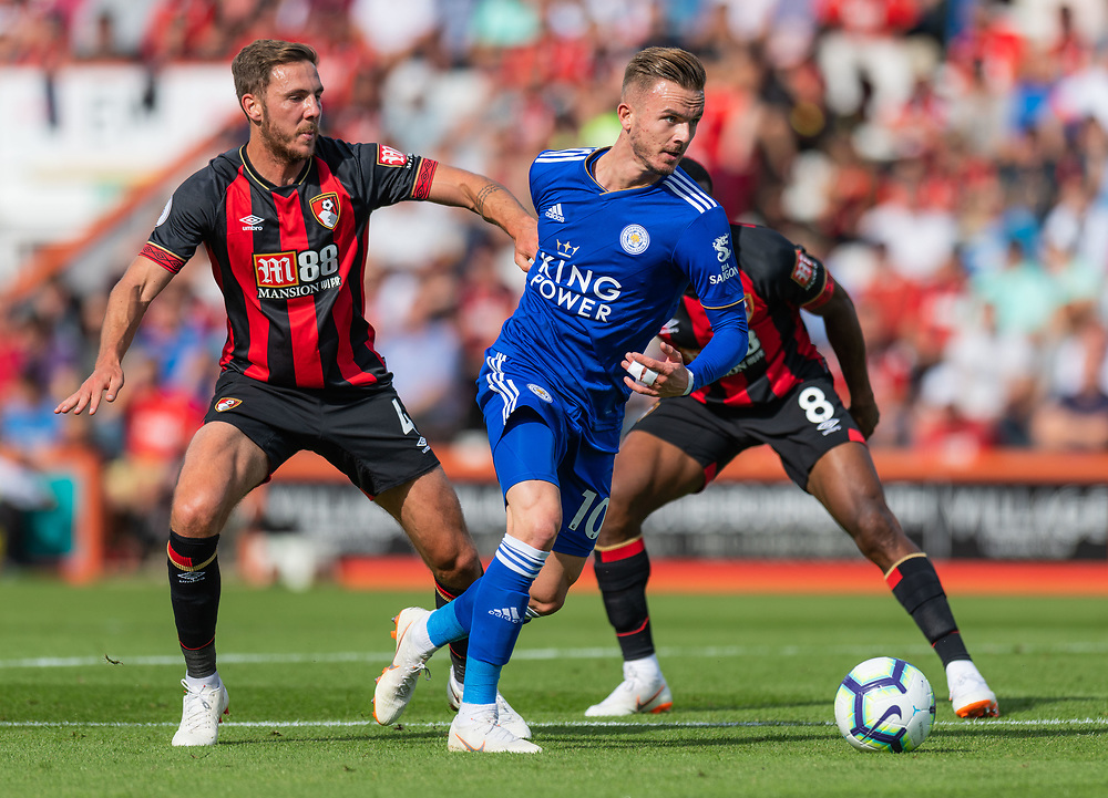 Leicester City's James Maddison (centre) under pressure from Bournemouth's Dan Gosling (left) & Jefferson Lerma (right) <br /> <br /> Photographer David Horton/CameraSport<br /> <br /> The Premier League - Bournemouth v Leicester City - Saturday 15th September 2018 - Vitality Stadium - Bournemouth<br /> <br /> World Copyright © 2018 CameraSport. All rights reserved. 43 Linden Ave. Countesthorpe. Leicester. England. LE8 5PG - Tel: +44 (0) 116 277 4147 - admin@camerasport.com - www.camerasport.com