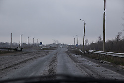 The approach to Debalsevo from Lugansk in the east, along the newly finished motorway, bears the scars of the fierce battles that fought her in Februsry 2015. The road is pitted with holes from explosions and debris.