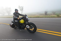 Doug Wothke riding his 1929 Harley-Davidson JD in the fog at the beginning of Stage 8 of the Motorcycle Cannonball Cross-Country Endurance Run, which on this day ran from Junction City, KS to Burlington, CO., USA. Saturday, September 13, 2014.  Photography ©2014 Michael Lichter.