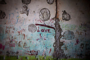 "The word ""love"" written to the wall at one of the staircases in a decrepit building at the Lunik IX housing estate which is home to the largest Roma community in Slovakia. It is located a few kilometers away from the historical city centre, on the outskirts of the eastern Slovakian city of Kosice. Since the beginning of the 1980s a large number of the Roma residents living in the city and in nearby settlements have been moved to Lunik IX."