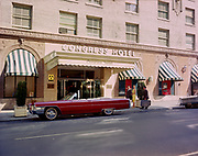 """Ackroyd C01063-8. """"Congress Hotel. Exterior of building with models. April 11, 1965"""" (1024 SW 6th, corner of Main. Demolished in 1970s, now site of the Congress Center, a skyscraper)"""