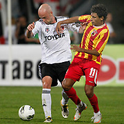 Besiktas's Fabian ERNST (L) and Alania Vladikavkaz's Danilo NECO (R) during their UEFA Europa League Play-Offs first leg match soccer match Besiktas between Alania Vladikavkaz at Inonu stadium in Istanbul Turkey on Thursday August 18, 2011. Photo by TURKPIX