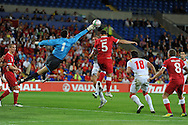 Montenegro keeper Mladen Bozovic saves from Darcy Blake of Wales (5). Euro 2012 Qualifying match, Wales v Montenegro at the Cardiff City Stadium in Cardiff  on Friday 2nd Sept 2011. Pic By  Andrew Orchard, Andrew Orchard sports photography,